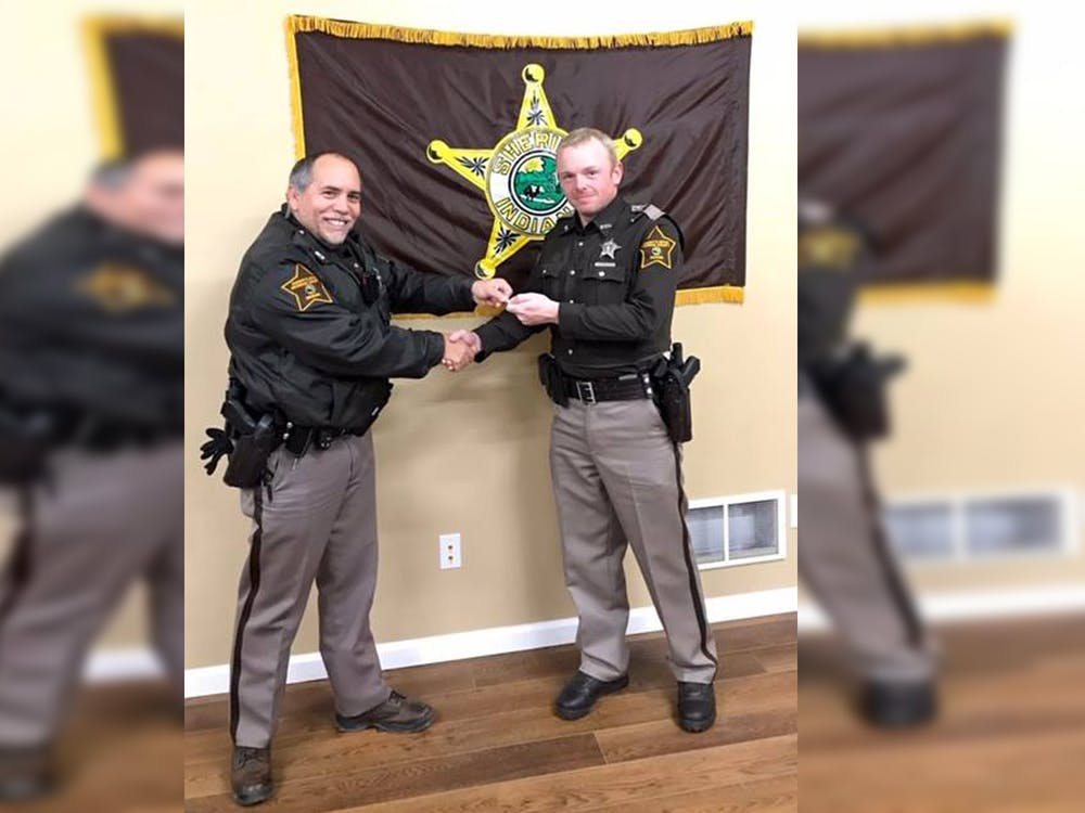 Monroe County Sheriff's Office Deputy James A. Driver, right, poses with Vince Gaitani, left, a Reserve Deputy who oversees the Reserve Unit. Driver, 38, died in a car crash Monday while he was responding to an emergency call.