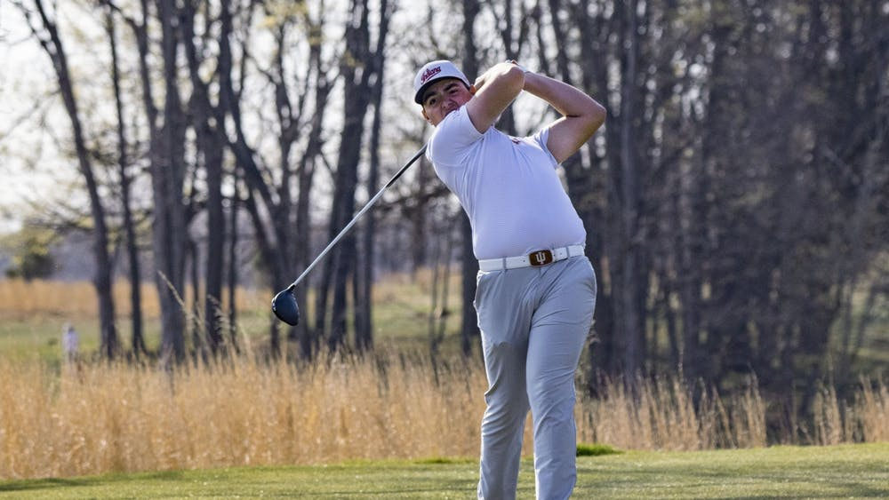 Then-freshman Drew Salyers follows through his swing after hitting the ball during the Hoosier Collegiate Invitational April 4, 2021, at the Pfau Golf Course. Salyers is ranked No. 12 in the nation.