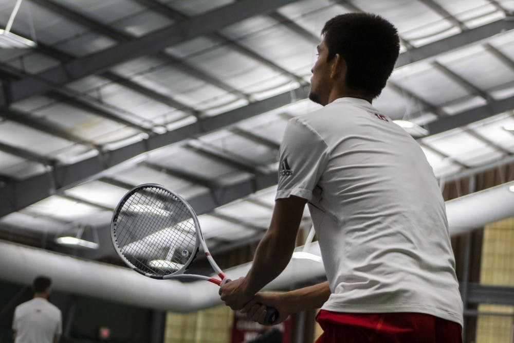 <p>Then-sophomore Brandon Lam prepares to return a serve April 14, 2019, at the IU Tennis Center. The Hoosiers&#x27; match scheduled for Saturday was canceled Tuesday due to COVID-19 issues in Purdue&#x27;s program.</p>