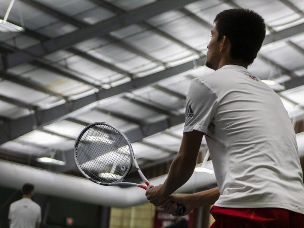 Then-sophomore Brandon Lam prepares to return a serve April 14, 2019, at the IU Tennis Center. The Hoosiers' match scheduled for Saturday was canceled Tuesday due to COVID-19 issues in Purdue's program.