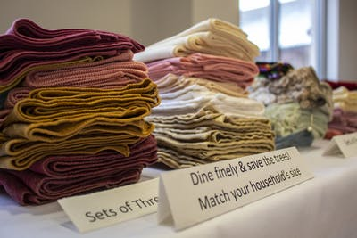 Sets of cloth napkins lie on a table Jan. 20 during the Martin Luther King Day Community Energy Fair at Evangelical Community Church. The energy fair had nine energy stations for attendees to visit.