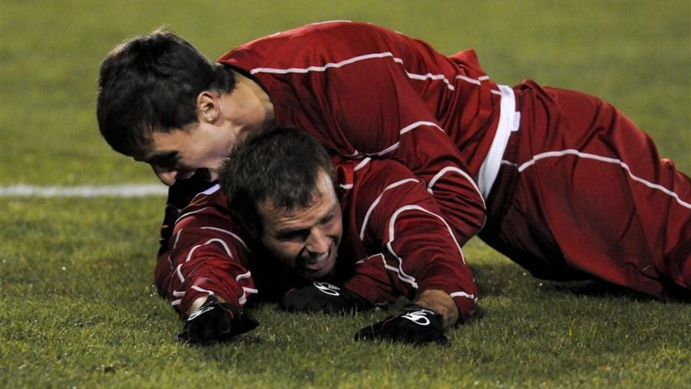 Redshirt freshman midfielder Nick Blevins dives onto senior forward Darren Yeagle in celebration of Indiana's first goal against the University of Louisville during the first round of the NCAA Men's Soccer Tournament on Thursday at Bill Armstong Stadium. Indiana's 2-0 shutout advanced them to the second round against Butler at 2 p.m. Sunday at Bill Armstrong Stadium.