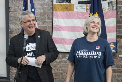 Mayor John Hamilton and his wife Dawn Johnsen smile May 7, 2019, at the Dimension Mill. Johnsen tested positive for COVID-19 on Thursday, according to a press release from the City of Bloomington.