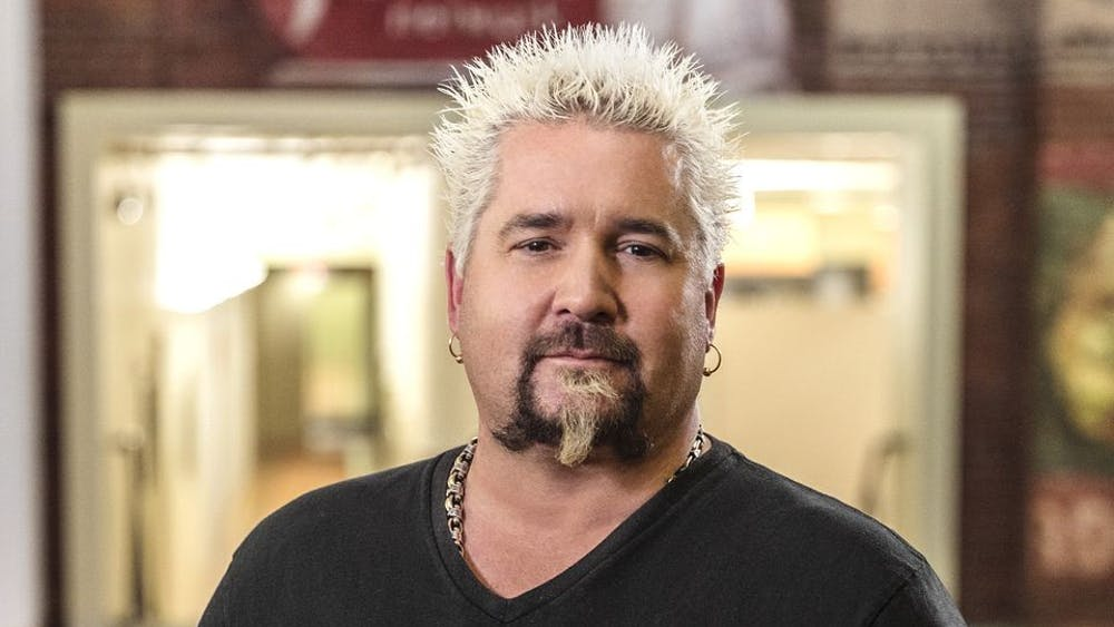 Guy Fieri poses for a photo at the offices of Food Network.