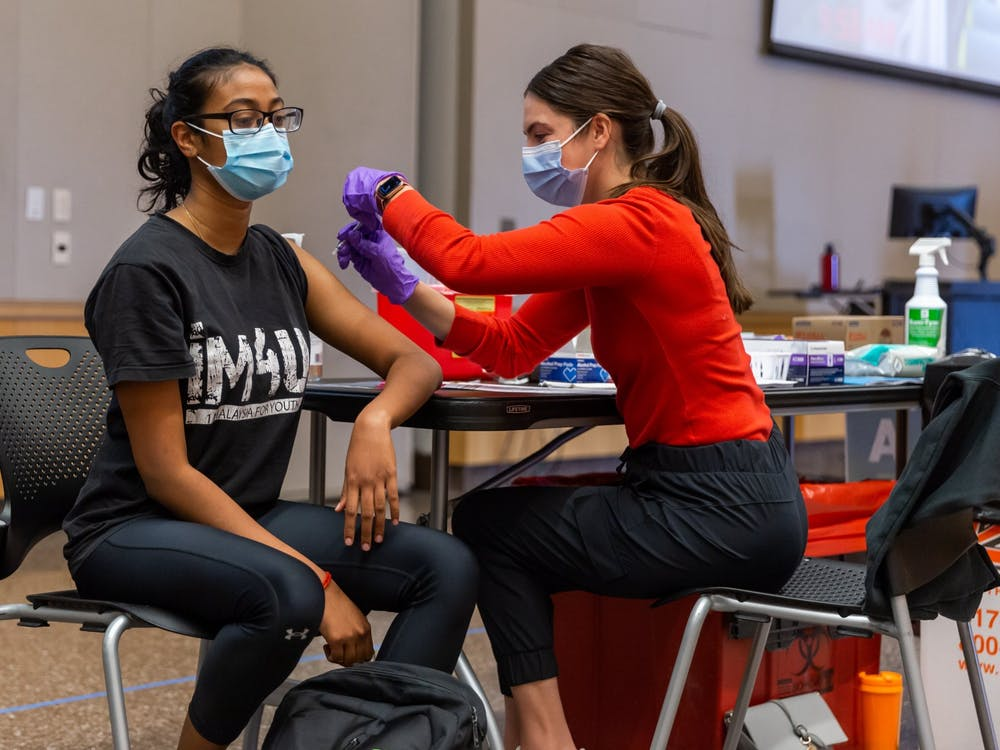 A COVID-19 vaccine is administered to a patient Tuesday at the IUPUI Campus Center clinic. IUPUI's vaccine clinic opened Tuesday and is open to IUPUI students, faculty and staff.