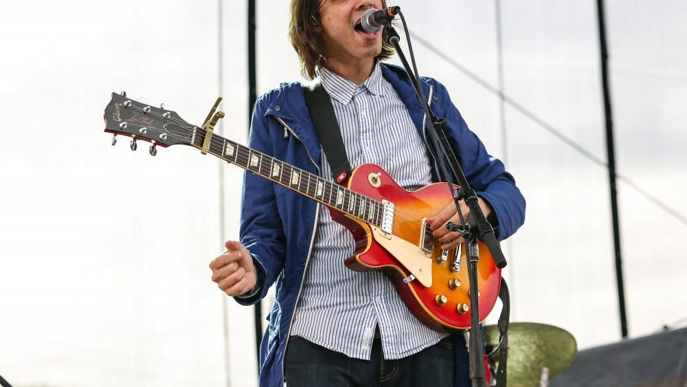 "David Longstreth from the band Dirty Projectors plays at a concert in 2013. The Brooklyn indie-rock band recently released its eighth album, ""Lamp Lit Prose."""