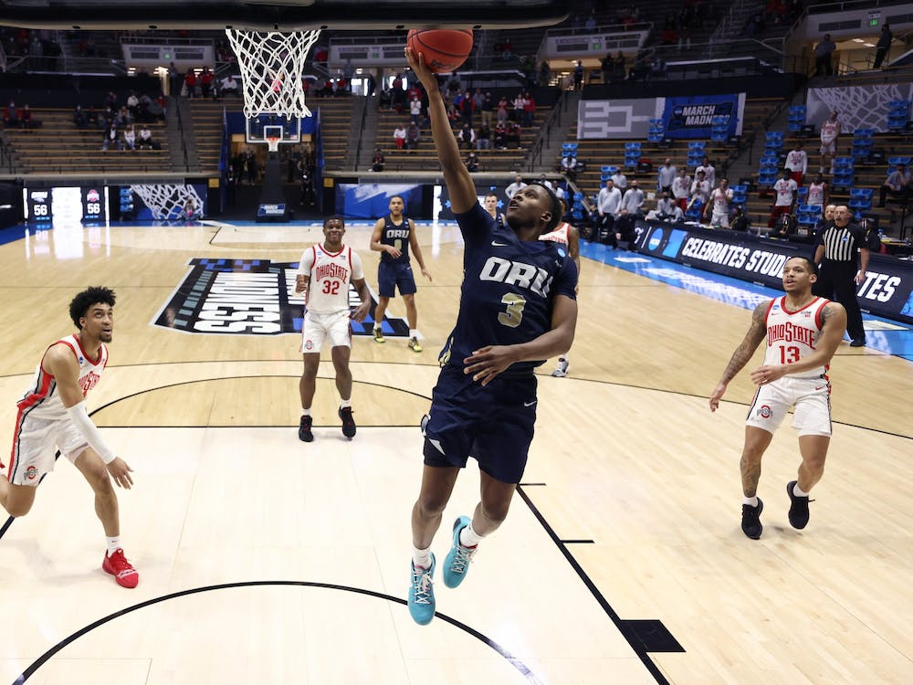 Oral Roberts University guard Max Abmas drives to the basket against Ohio State in the first-round game of the 2021 NCAA Men's Basketball Tournament on March 19 at Mackey Arena in West Lafayette, Indiana. The Golden Eagles beat the Buckeyes 75-72 to advance to the next round.