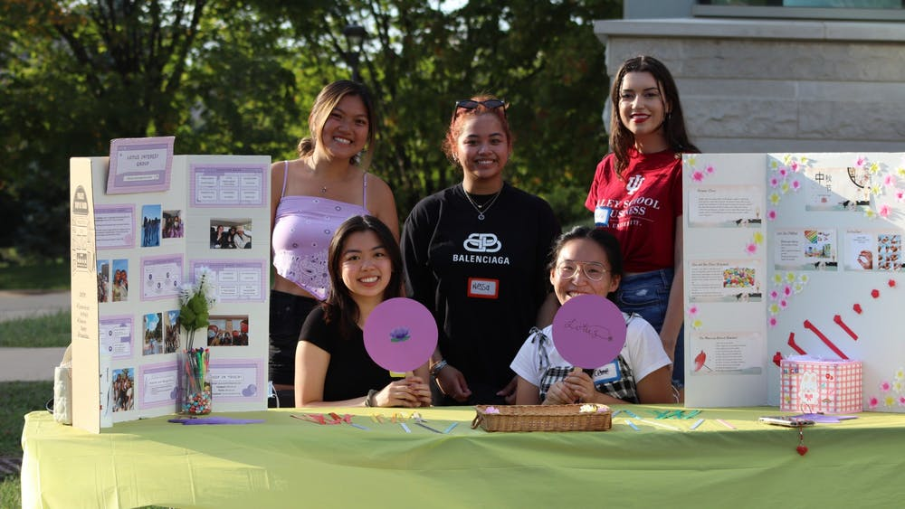 Lotus Interest Group poses for a photo at their origami craft booth table during the Mid-Autumn Festival on Sept. 18, 2021, at Hamilton Lugar School of Global and International Studies South Lawn. Over 200 people attended the IU Asian American Association's Mid-Autumn Festival celebration Saturday evening.