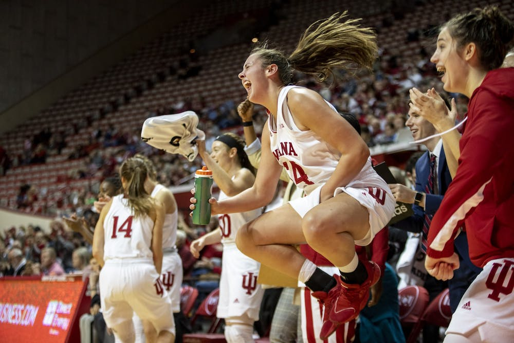 Freshman Mackenzie Holmes celebrates after a play Nov. 10 at Simon Skjodt Assembly Hall. Holmes was able to score 22 points during the game.