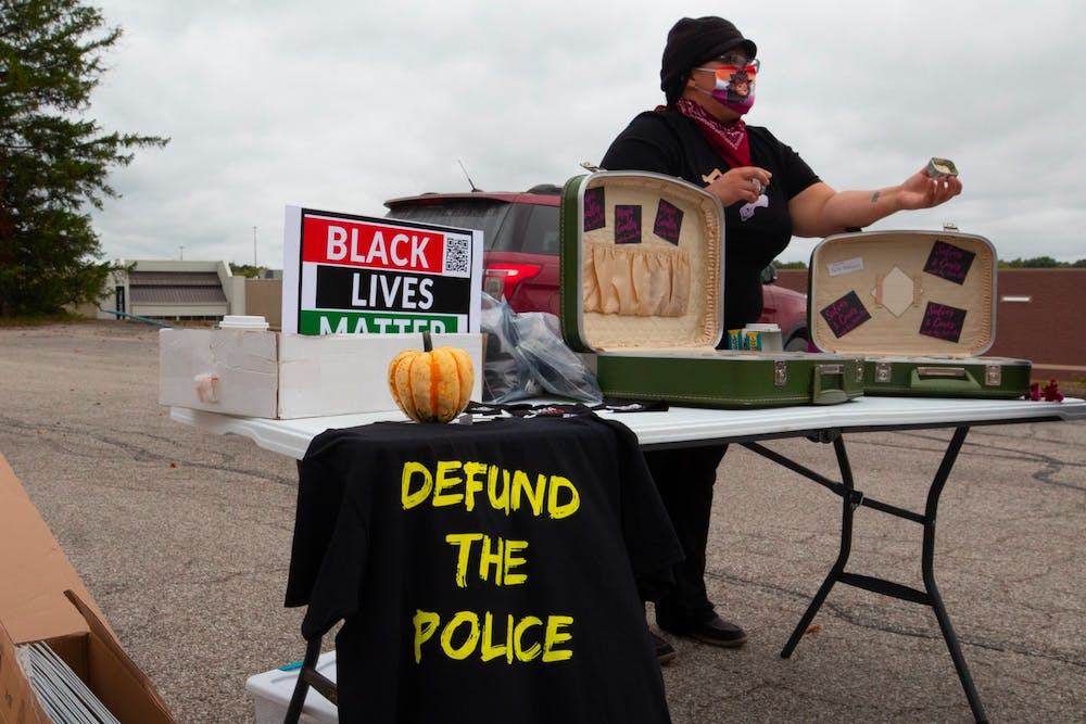 <p>Jada Bee presents their products to shoppers at the People&#x27;s Market on Sept. 26, 2020, in Bloomington. Bee has not actively sought updates on Minneapolis Police Department officer Derek Chauvin&#x27;s trial because they want to avoid reliving the trauma of George Floyd&#x27;s killing.</p><p></p><p></p>