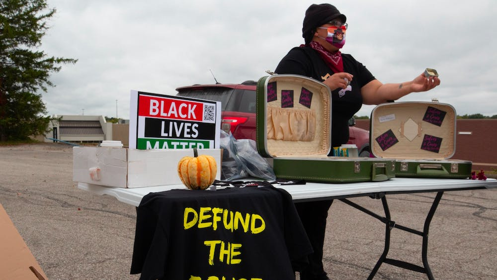 Jada Bee presents their products to shoppers at the People's Market on Sept. 26, 2020, in Bloomington. Bee has not actively sought updates on Minneapolis Police Department officer Derek Chauvin's trial because they want to avoid reliving the trauma of George Floyd's killing.