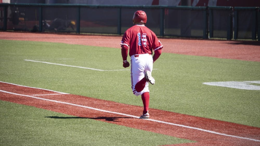 Senior utility Matt Lloyd runs to first base March 23 at Bart Kaufman Field. Lloyd upped his team-high reached base streak to 16 games with his RBI double.