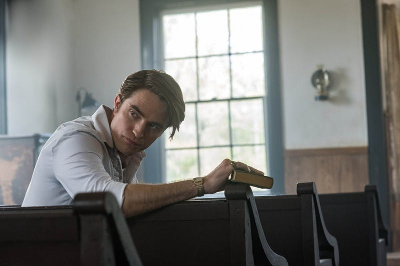 "Robert Pattinson plays the role of Rev. Preston Teagardin in ""The Devil All The Time."""