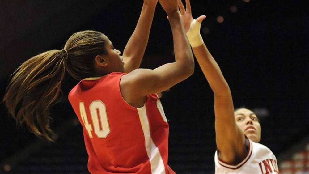 Ohio State guard Brittany Johnson shoots over IU forward Whitney Thomas during the second half of a game Sunday in Bloomington. No. 20 Ohio State won 79-67.