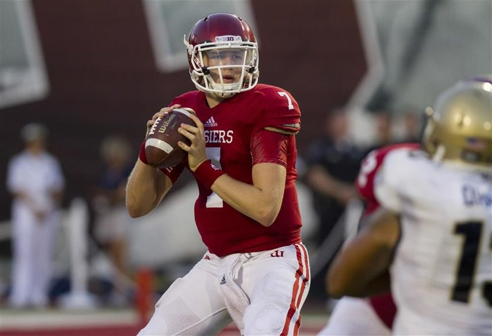 <p>Then-sophomore quarterback Nate Sudfeld prepares to pass the ball during IU's 41-35 loss to Navy in 2013 at Memorial Stadium. Sudfeld threw his first touchdown pass in the NFL this weekend for the Philadelphia Eagles.</p>