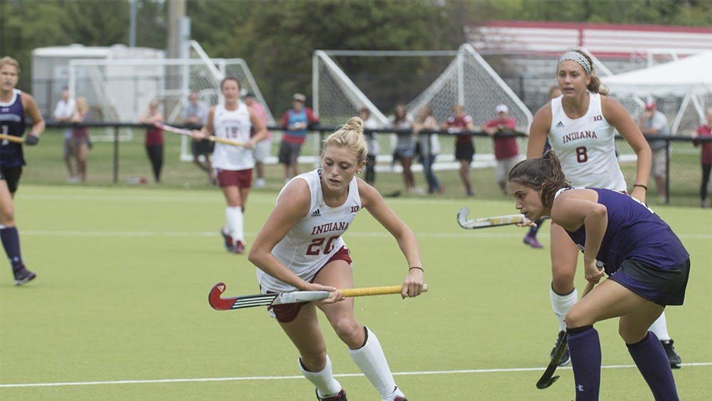 Sophomore Maddie Latino moves to evade a Northwestern defender on Sunday at the IU Field Hockey Complex. Latino was named Big Ten co-offensive player of the week for her performance in IU's victories over #16 Iowa and #14 Northwestern.