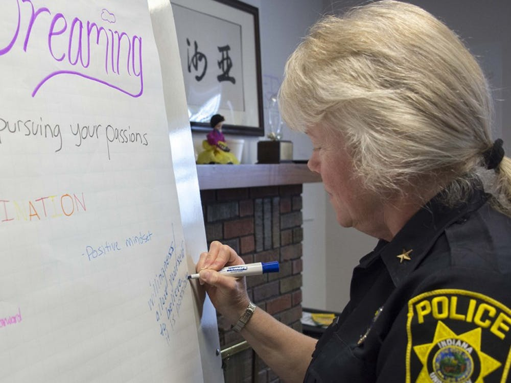Laury Flint, Chief of Indiana University Police Department, writes donw her new year resolution during the workshop at Asian Culture Center, Jan 13.
