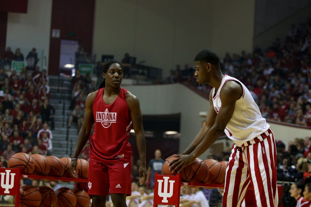 <p>Sophomore guard Al Durham competes with sophomore guard Bendu Yeaney in a 3-point shooting contest during Hoosier Hysteria on Sept. 29 in Simon Skjodt Assembly Hall.&nbsp;</p>