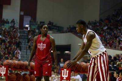 Sophomore guard Al Durham competes with sophomore guard Bendu Yeaney in a 3-point shooting contest during Hoosier Hysteria on Sept. 29 in Simon Skjodt Assembly Hall.