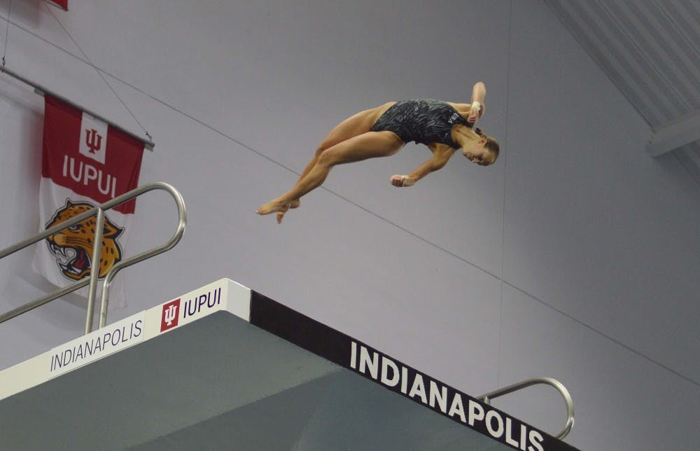 <p>IU diver Jessica Parratto dives off the 10-meter platform during Olympic Trials Saturday night at the IUPUI Natatorium. Parratto placed first, earning a spot on Team USA.</p>