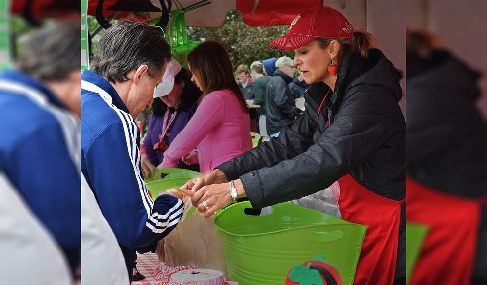 <p>Krista Johns, co-chair of the Strawberry Shortcake Festival in 2016, sells Strawberry to customer during the Strawberry Shortcake Festival. The Strawberry Shortcake Festival is one of the two major fundraising events the Auxiliary to the Boys and Girls Clubs of Bloomington hosts each year in order to donate $75,000.<br/></p>