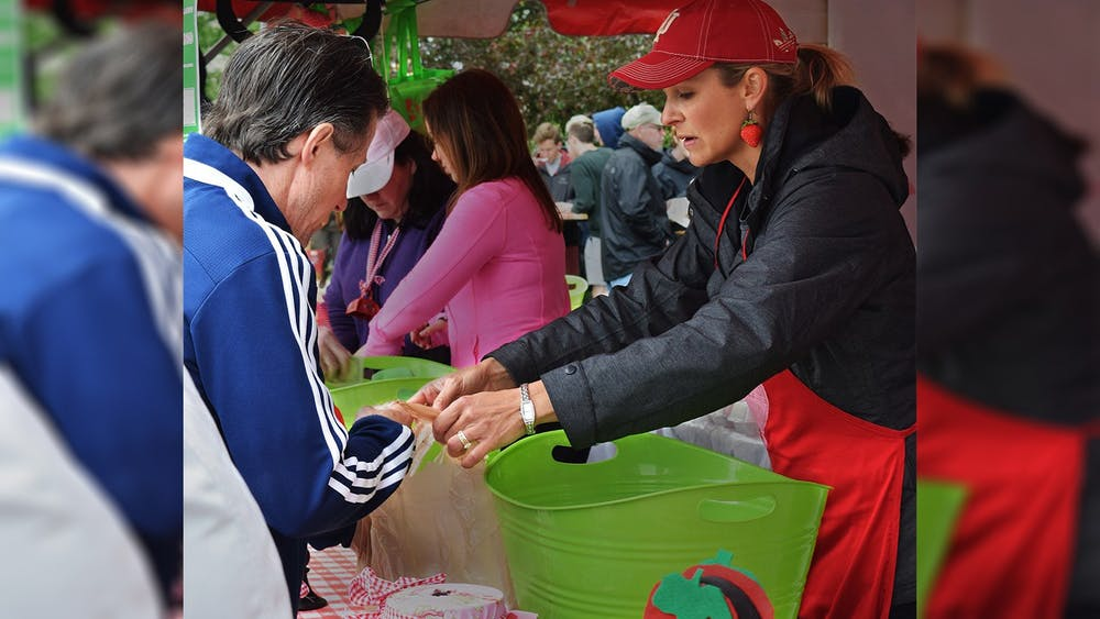 Krista Johns, co-chair of the Strawberry Shortcake Festival in 2016, sells Strawberry to customer during the Strawberry Shortcake Festival. The Strawberry Shortcake Festival is one of the two major fundraising events the Auxiliary to the Boys and Girls Clubs of Bloomington hosts each year in order to donate $75,000.