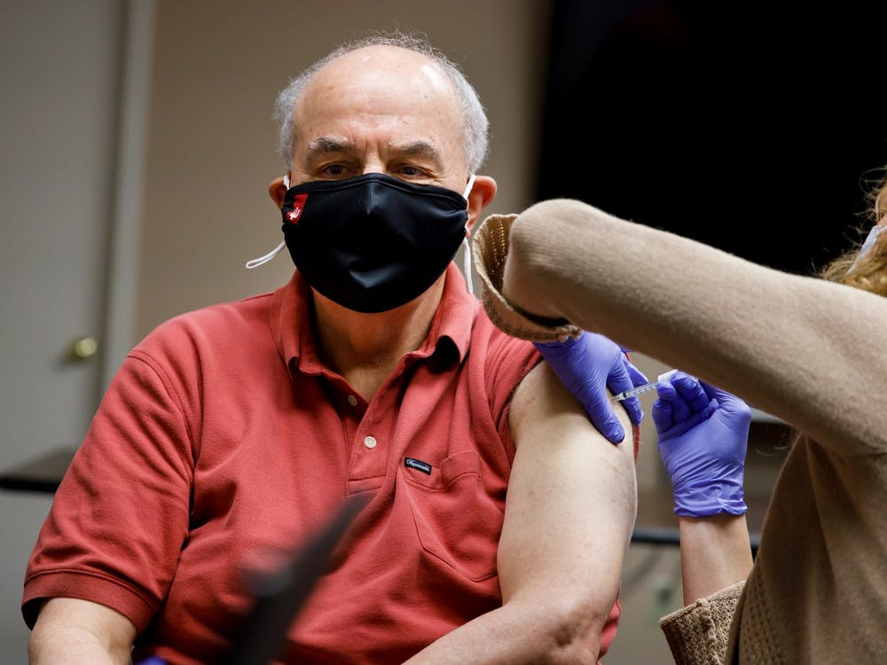 IU President Michael A. McRobbie receives his first dose of the Pfizer COVID-19 vaccine at IU Health Bloomington on Jan. 16. IU opened a vaccination site at Assembly Hall in March.