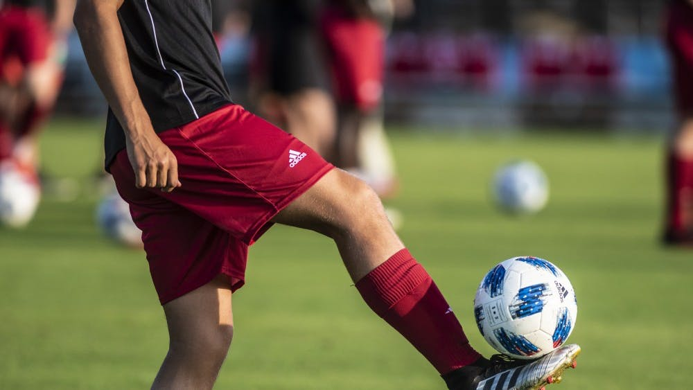 Freshman Andrew Goldsworthy balances a ball on his foot during warmups Sept. 17 at Bill Armstrong Stadium. The first 500 fans at the match received a voucher for a free scarf.