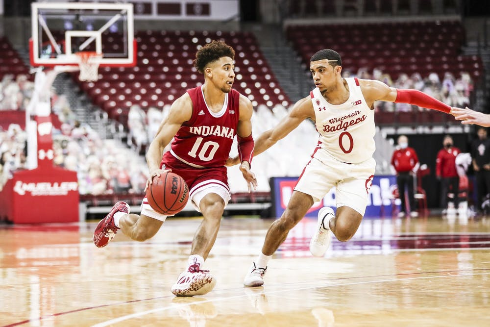 <p>Junior guard Rob Phinisee dribbles toward the basket Jan. 7 at the Kohl Center in Madison, Wisconsin. Phinisee scored 10 points against Wisconsin. </p>