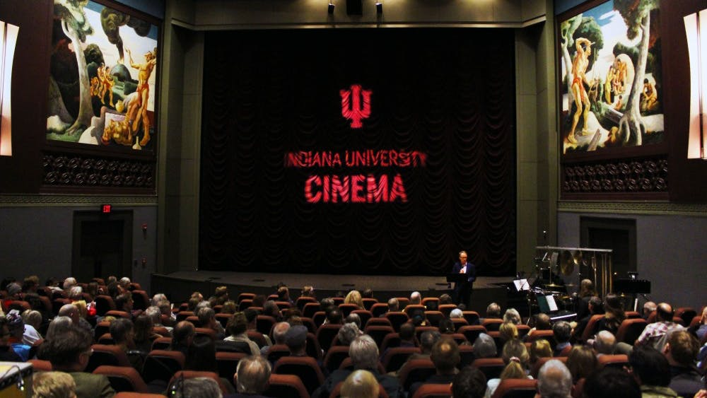 """IU Cinema founding director Jon Vickers introduces the Alloy Orchestra on Oct. 17 in IU Cinema. The ensemble provided accompaniment for the silent film """"Speedy."""""""