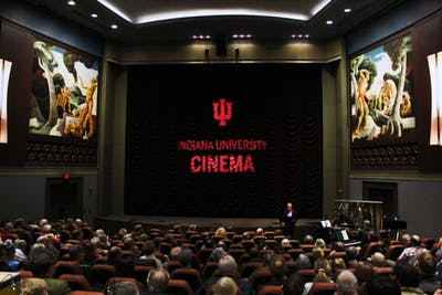"IU Cinema founding director Jon Vickers introduces the Alloy Orchestra on Oct. 17 in IU Cinema. The ensemble provided accompaniment for the silent film ""Speedy."""