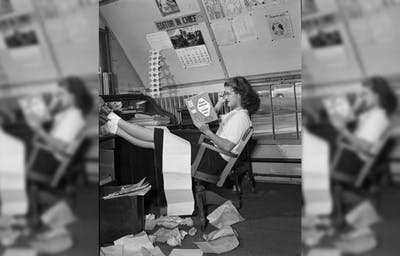 "Marge Blewett sits kicked back on a chair, her feet on the IDS editor's desk reading Alfred Kinsey's ""Sexual Behavior in the Human Male."""