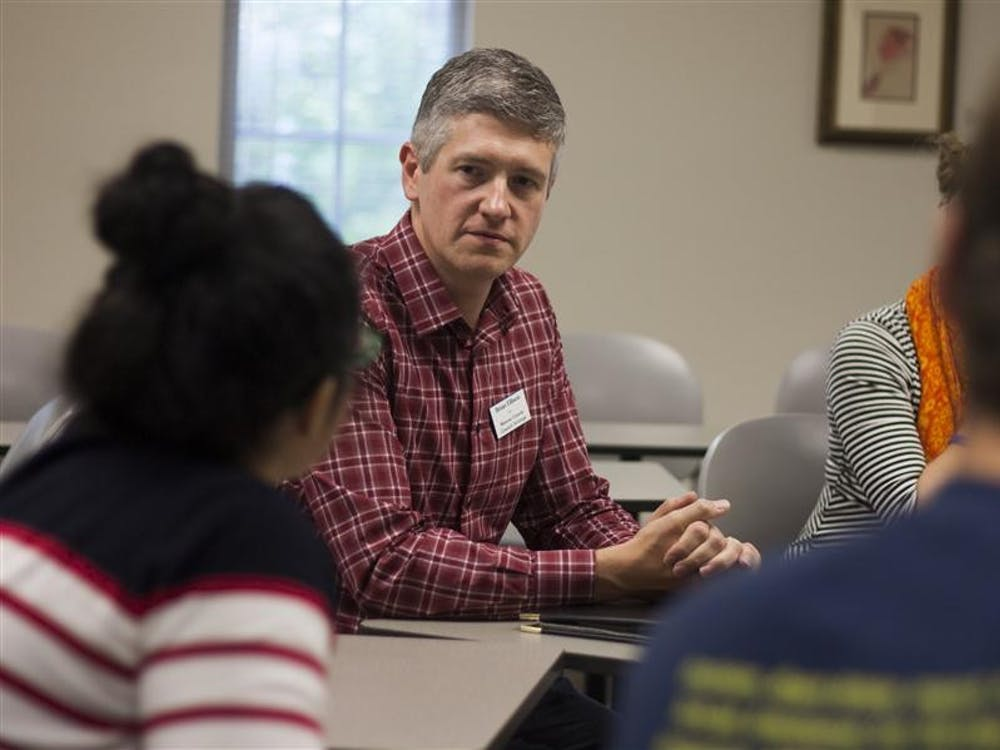 Brian Ellison, a candidate running for the Monroe County Council position, listens to a student's question on Thursday at the local candidate's forum. The forum took place at the Hutton Honors College.