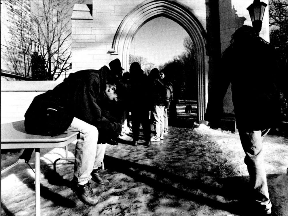 Then-freshman Johanna Meadows (left) waits in the cold Jan. 20, 1997, at the Sample Gates where the protest for better diversity support ended. The  Student Coalition protested for better diversity support from the university.