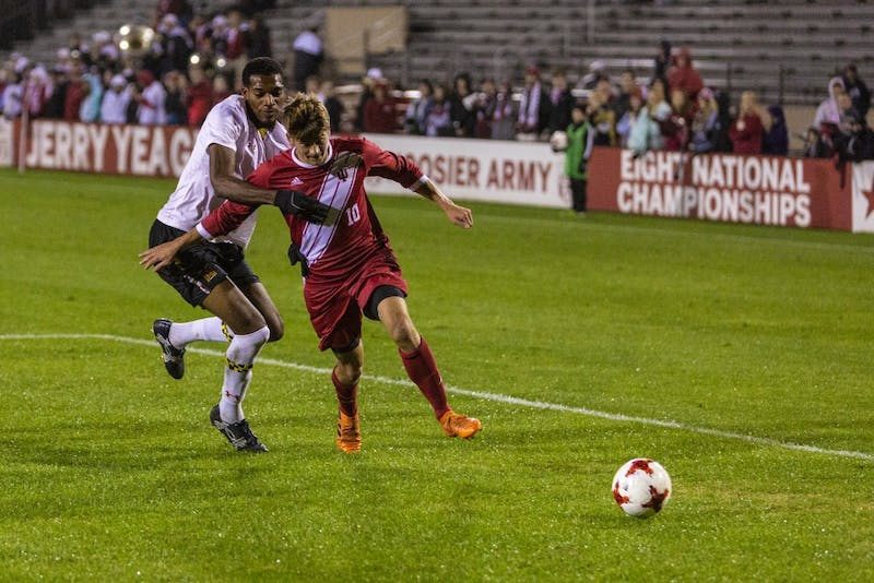 Maryland junior defender Donovan Pines attempts to tackle sophomore midfielder Justin Rennicks on Oct. 12 at Bill Armstrong Stadium. IU defeated Maryland, 2-1. IU faces Butler at home on Tuesday.