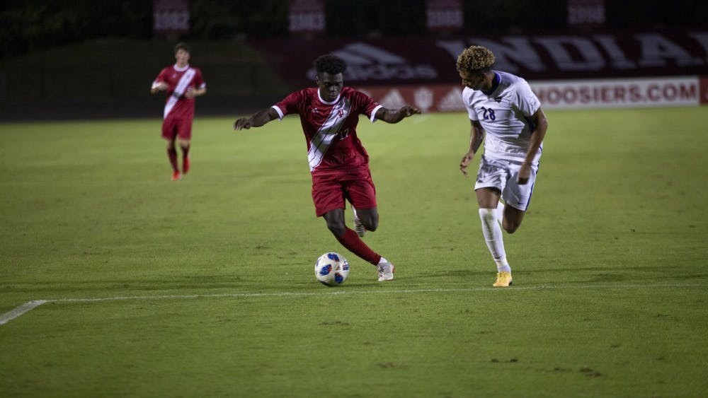 Freshman forward Herbert Endeley dribbles the ball away from University of PIttsburghjunior Tim Ekpone on Aug. 30 at Bill Armstrong Stadium. IU won its first home match against​ the University of Pittsburgh, 3-2.