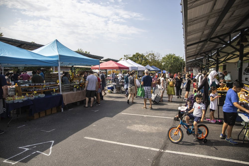 <p>A crowd of people visit stalls at the Sept. 11, 2021, at the Bloomington Community Farmers' Market. The weekly farmers market is located at 401 N Morton St.</p>