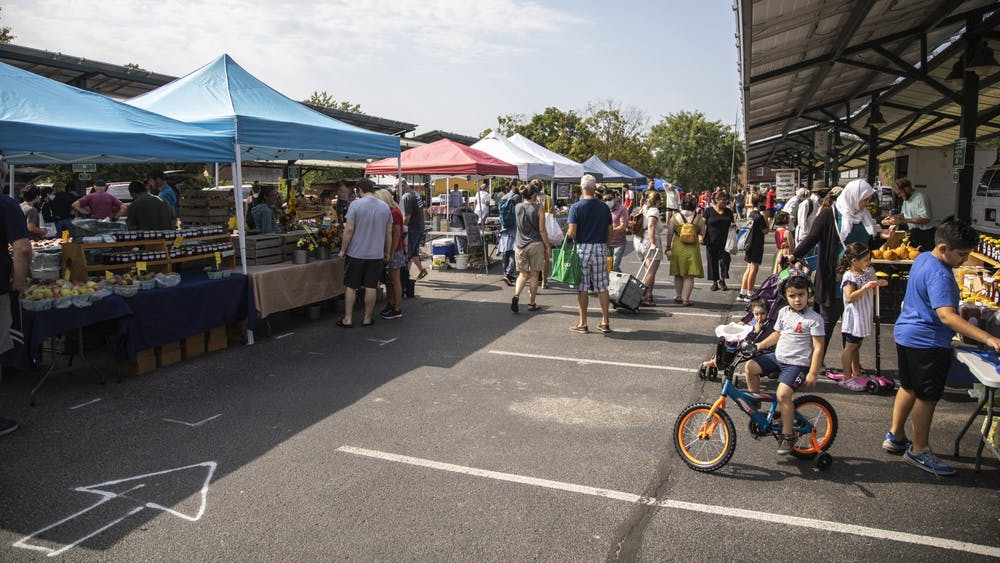 A crowd of people visit stalls at the Sept. 11, 2021, at the Bloomington Community Farmers' Market. The weekly farmers market is located at 401 N Morton St.