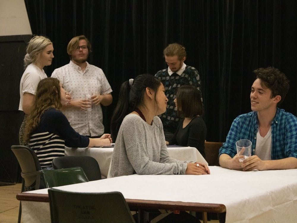 """Student actors rehearse for the upcoming production of """"The Big Meal,"""" an independent play produced by University Players. The actors got into character and practiced their blocking for opening night, which is 7:30 p.m. April 19 in the Lee Norvelle Theatre and Drama Center A200."""