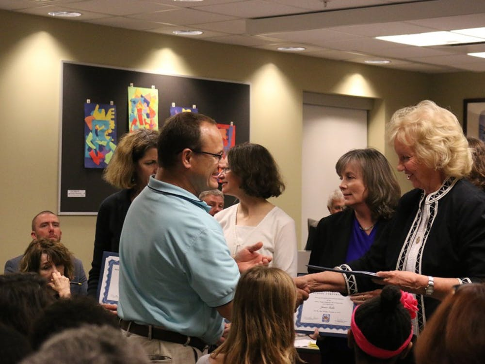 Board members give the YesforMCCSC campaign volunteers a standing ovation at Tuesday night's board meeting.