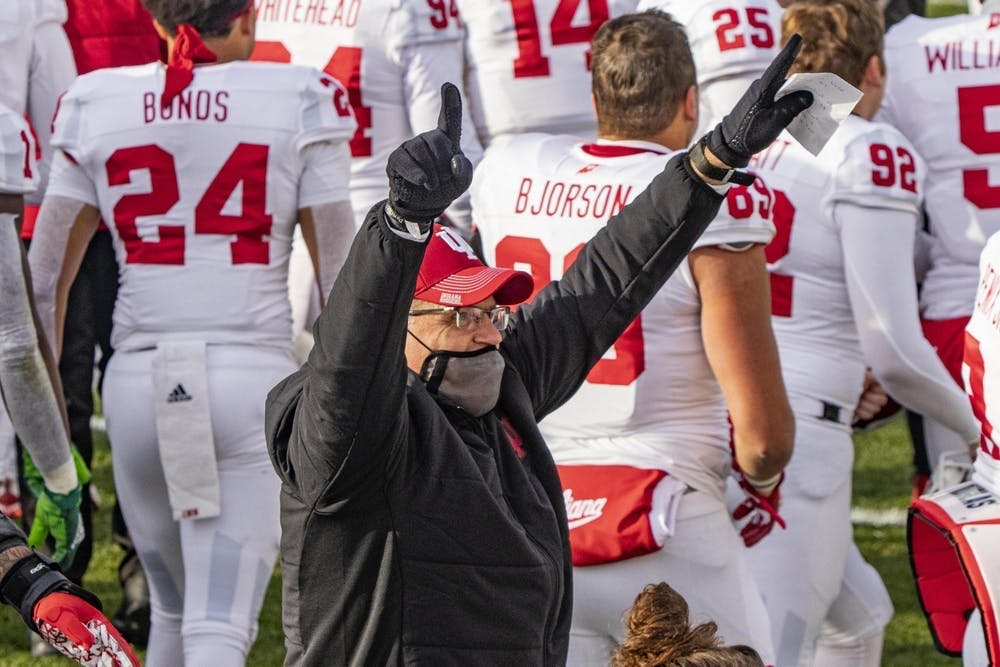 <p>IU football head coach Tom Allen points into the air Nov. 14, 2020, in Spartan Stadium in East Lansing, Michigan. IU football announced on Sunday the hiring of Georgia defensive backs coach Charlton Warren as defensive coordinator.</p>