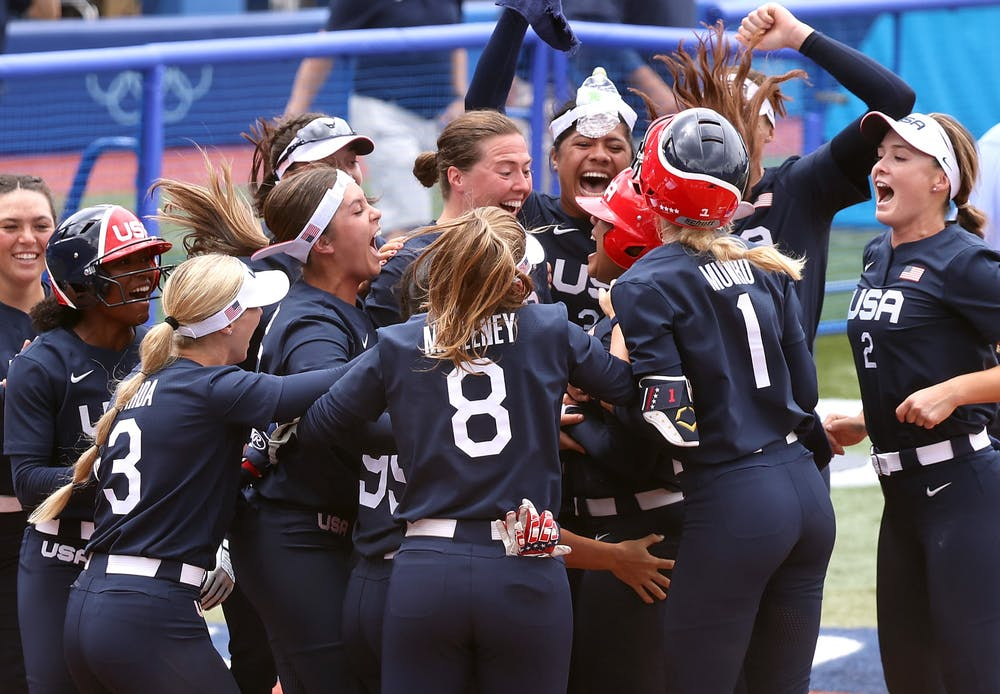 <p>Team USA players celebrate with teammate Kelsey Stewart after she hit a walk-off home run to win the game 2-1 against Team Japan on day three of the Tokyo 2020 Olympic Games on Monday, July 26, 2021 at Yokohama Baseball Stadium  in Yokohama, Kanagawa, Japan. Softball was played on a baseball field in the Tokyo Olympics.</p>