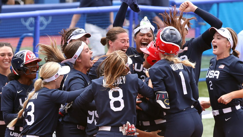 Team USA players celebrate with teammate Kelsey Stewart after she hit a walk-off home run to win the game 2-1 against Team Japan on day three of the Tokyo 2020 Olympic Games on Monday, July 26, 2021 at Yokohama Baseball Stadium  in Yokohama, Kanagawa, Japan. Softball was played on a baseball field in the Tokyo Olympics.