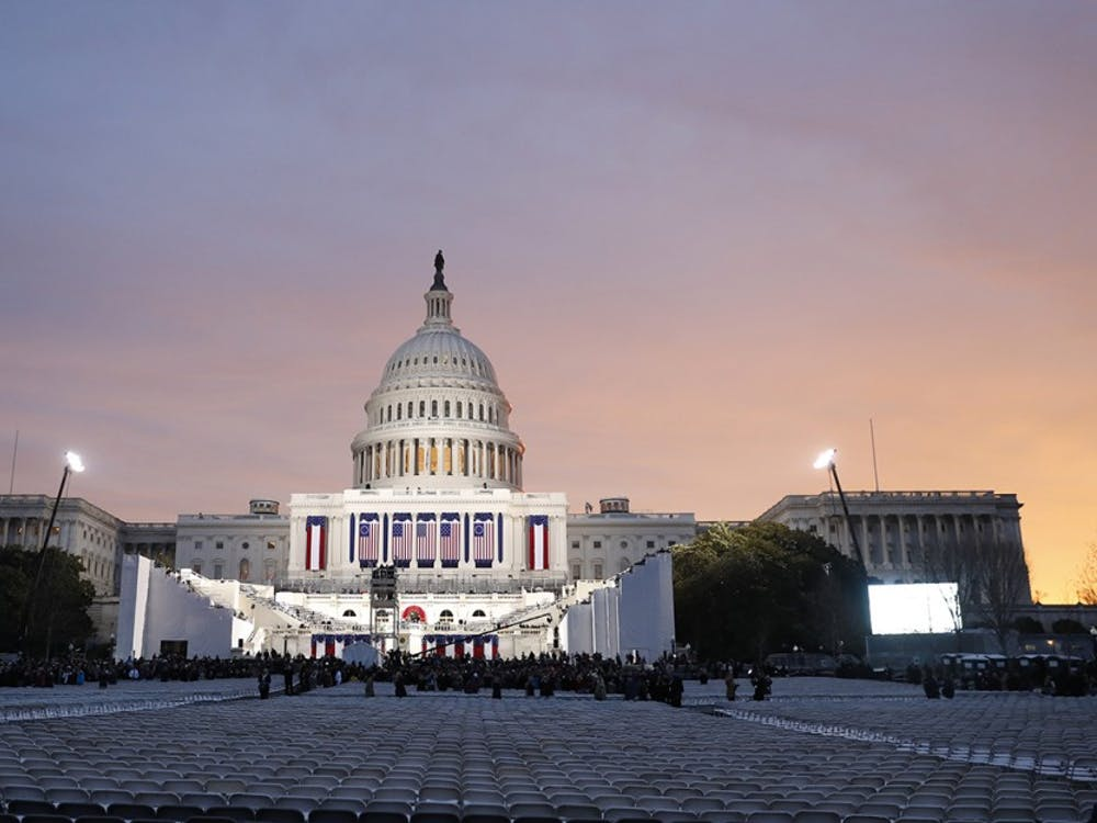 The sun rises over the United States Capitol Building.