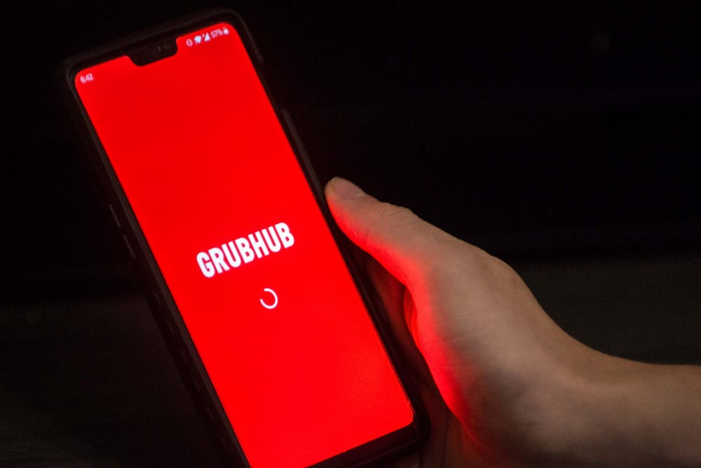 <p>A student opens the Grubhub app on their phone Aug. 26. IU Dining has partnered with Grubhub to allow for delivery and carryout orders at campus dining halls.</p>