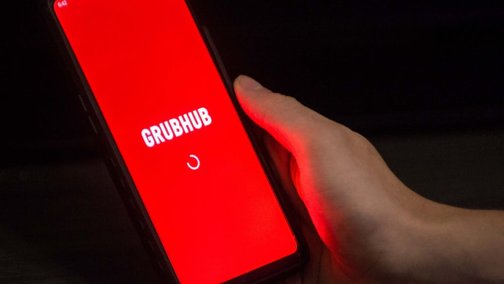 A student opens the Grubhub app on their phone Aug. 26. IU Dining has partnered with Grubhub to allow for delivery and carryout orders at campus dining halls.