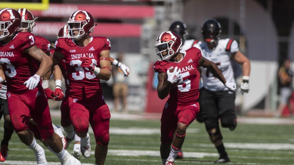 Redshirt senior J-Shun Harris II returns a punt for a touchdown during a game against Ball State on Sept. 15 at Memorial Stadium. Harris had eight receptions for 104 yards Saturday against No. 3 Ohio State.