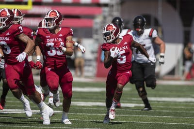 Redshirt senior J-Shun Harris II returns a punt for a touchdown during a game against Ball State on Sept. 15 at Memorial Stadium. IU will take on Michigan State Sept. 22.