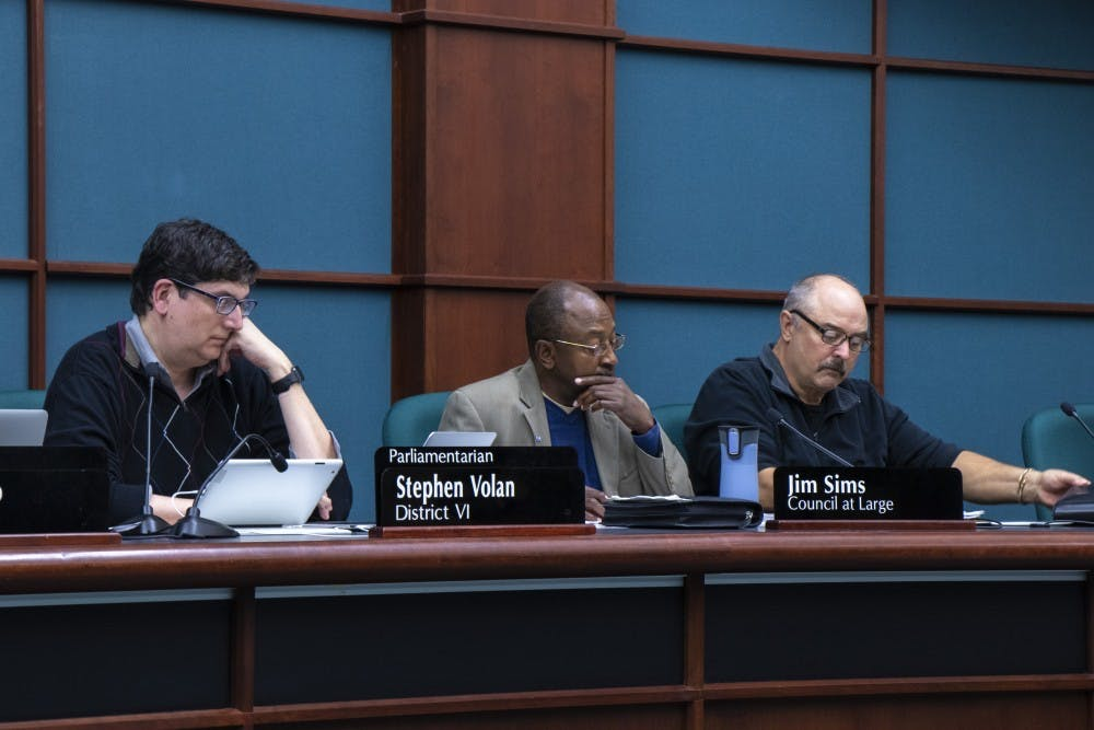 <p>Bloomington city council members Stephen Volan, Jim Sims and Chris Sturbaum listens to public comment Oct. 23 at City Hall. The council discussed chapters six and seven of the city&#x27;s Unified Development Ordinance on Wednesday night.</p>