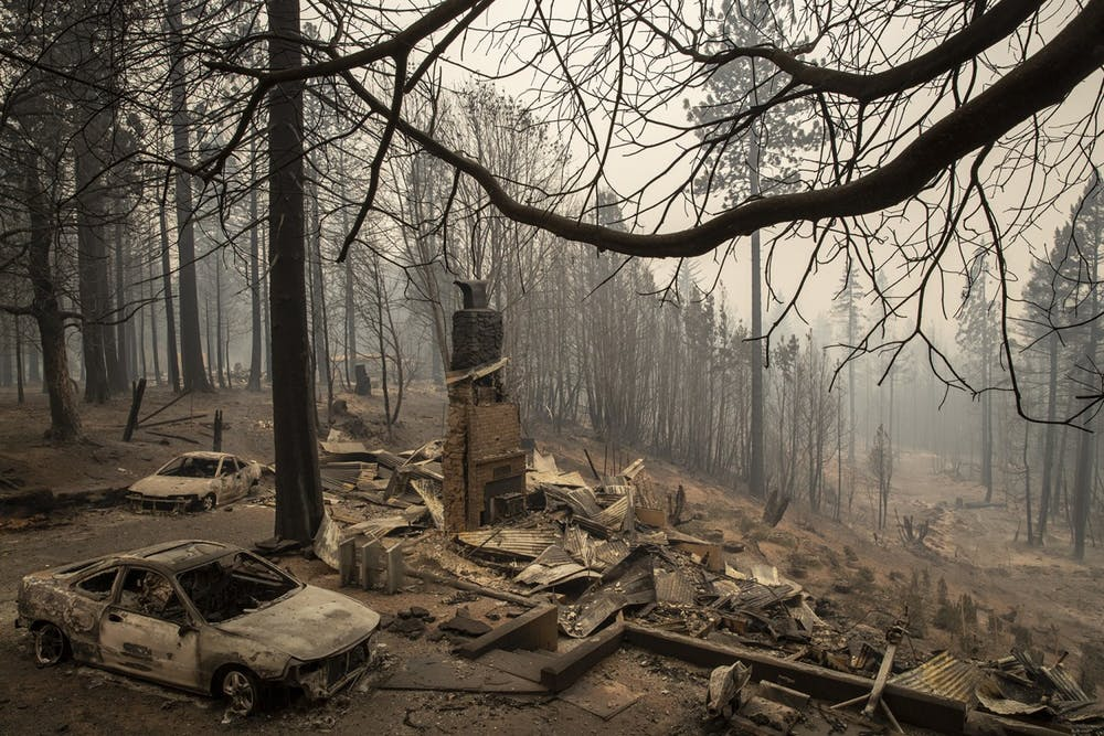 <p>A home smolders in ruins in the aftermath of the Bear fire Thursday in Brush Creek, California.</p>